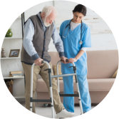 caregiver assisting senior man in walking